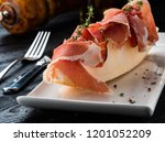 parma ham with melon on a white ... | Shutterstock . vector #1201052209