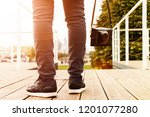 man with a camera against the...   Shutterstock . vector #1201077280