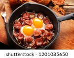 cooked egg and sausages on... | Shutterstock . vector #1201085650