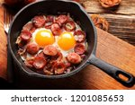 cooked egg and sausages on... | Shutterstock . vector #1201085653