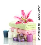 towels with lily, aroma oil,  candles and soap isolated on white - stock photo