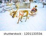 girls in reindeer sleigh in... | Shutterstock . vector #1201133536