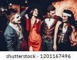 group of friends in halloween... | Shutterstock . vector #1201167496