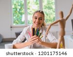 happy woman holding wooden... | Shutterstock . vector #1201175146