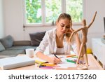woman leaning to draw | Shutterstock . vector #1201175260