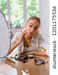 woman make up at her home | Shutterstock . vector #1201175536