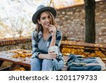 interested young lady with cup... | Shutterstock . vector #1201179733
