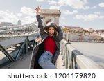 shapely blissful girl in red... | Shutterstock . vector #1201179820