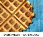 Belgian Waffles On Blue Wooden...