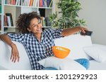 black woman watching tv at home ... | Shutterstock . vector #1201292923