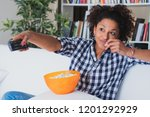 afro woman sitting at home with ... | Shutterstock . vector #1201292929