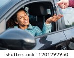 black car driver woman smiling... | Shutterstock . vector #1201292950