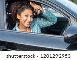 black car driver woman smiling... | Shutterstock . vector #1201292953