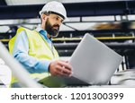a portrait of an industrial man ... | Shutterstock . vector #1201300399