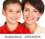 Portrait of a happy young mother with son 8 year old over white background - stock photo