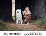 cute blonde girl stroking dog... | Shutterstock . vector #1201375330