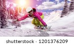snowboarder rides her snowboard ...