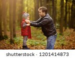 little boy with his father... | Shutterstock . vector #1201414873
