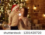 young mother with her little...   Shutterstock . vector #1201420720