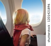 charming kid traveling by an... | Shutterstock . vector #1201421896