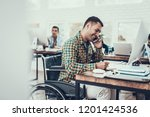 man on wheelchair write notes... | Shutterstock . vector #1201424536