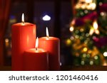 red candles glowing on the... | Shutterstock . vector #1201460416