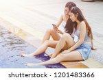 two young asian women relaxing... | Shutterstock . vector #1201483366