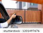 woman in car  hand using remote ... | Shutterstock . vector #1201497676