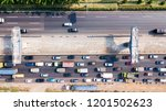 Small photo of West Java, Indonesia - October 10, 2018: Top view of the construction pilings of Jakarta-Cikampek elevated toll road project near hectic traffic on the highway