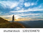 the man standing on the rock... | Shutterstock . vector #1201534870