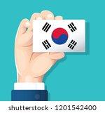 hand holding south korea flag... | Shutterstock .eps vector #1201542400