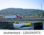 classic red big rig semi truck...   Shutterstock . vector #1201542973