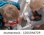 happy boys build vintage... | Shutterstock . vector #1201546729