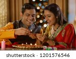young couple decorating the... | Shutterstock . vector #1201576546