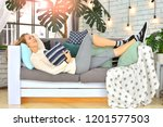 beautiful woman rests on a sofa ... | Shutterstock . vector #1201577503