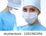 surgeon doctor in mask... | Shutterstock . vector #1201582396