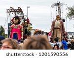 giant little girl leads the...   Shutterstock . vector #1201590556