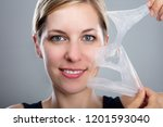 close up of a smiling woman... | Shutterstock . vector #1201593040