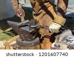 blacksmith manufactures a... | Shutterstock . vector #1201607740
