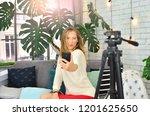 blogger girl grimacing in... | Shutterstock . vector #1201625650
