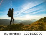 the woman with a camping... | Shutterstock . vector #1201632700