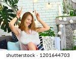 girl is fooling around. girl... | Shutterstock . vector #1201644703