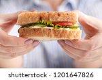 woman eats a big sandwich with...   Shutterstock . vector #1201647826