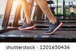 male feet in sneakers running... | Shutterstock . vector #1201650436