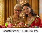 daughter in law decorating the... | Shutterstock . vector #1201659193