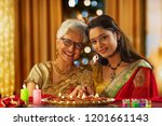 daughter in law decorating the... | Shutterstock . vector #1201661143