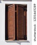 wooden window shutters of an... | Shutterstock . vector #1201665289