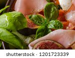 herby salad  fresh figs  baked... | Shutterstock . vector #1201723339