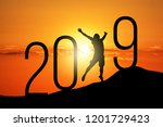 freedom silhouette man and 2019 ... | Shutterstock . vector #1201729423
