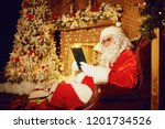 santa claus is reading a book... | Shutterstock . vector #1201734526